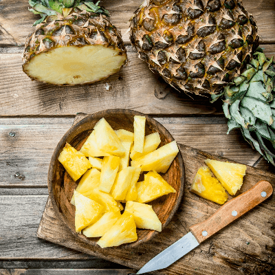 A Picture of a Pineapple and Cut Pineapple