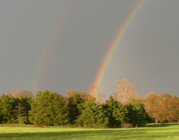 A picture of a primary and secondary rainbow
