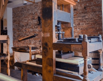 An image of a reconstruction of an 18th century wooden printing press