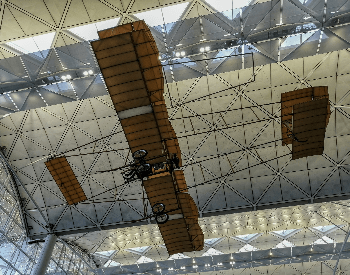 A picture of a replica of the Wright Flyer