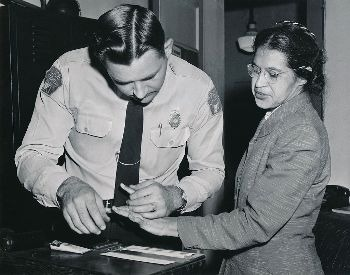 A picture of Rosa Parks being fingerprinted in 1956