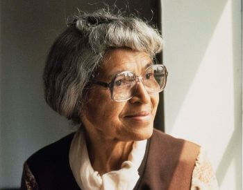 A picture of Rosa Parks in 1978 looking out a window