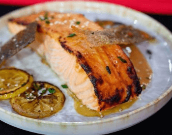 A picture of salmon, a food with a good source of protein
