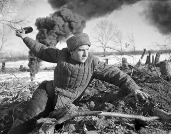 A picture of a Soviet Union solider throwing a grenade