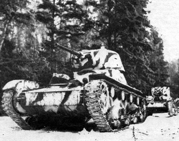 A picture of Soviet T-26 tanks moving to the front lines