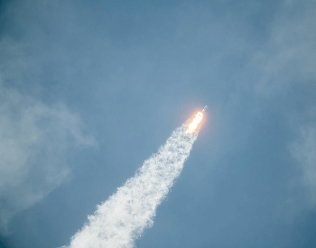 A picture of a SpaceX commerical rocket in the air