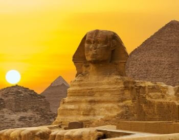 A picture of the Sphinx statue during a sunset