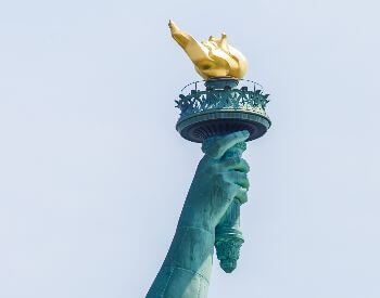 A close-up picture of the torch on the Statue of Liberty