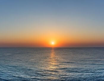 A picture of a sunset over the Pacific Ocean