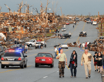 Survivors walking among destroyed homes after the 2011 Joplin Tornado