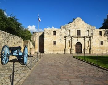 A picture of the Alamo and a cannon