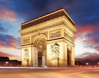 A picture of the Arc de Triomphe during a sunset