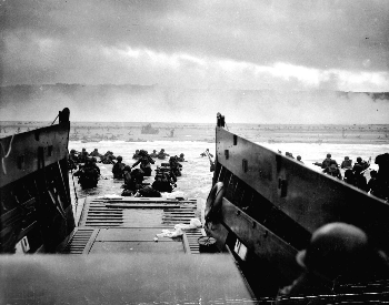 A picture of the first wave at Omaha beach on D-Day in Normandy