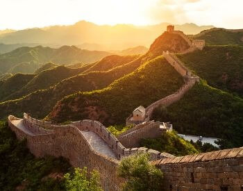 A picture of the Great Wall of China during sunset