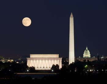 A picture of the Washington Monument and the Moon
