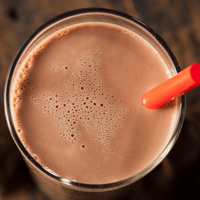 A Picture of the Top of a Glass of Chocolate Milk