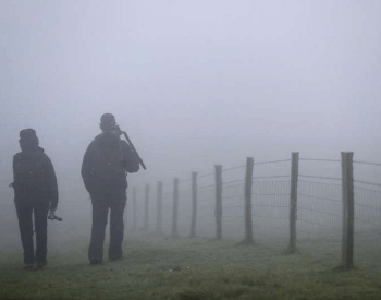 Two People in Foggy Conditions