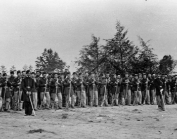 A picture of Union soliders by their camp and who fought at the Battle of Gettyburg