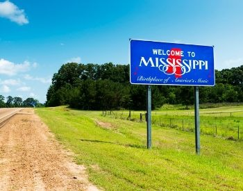 A picture of a sign on U.S. Highway 61 for Mississippi