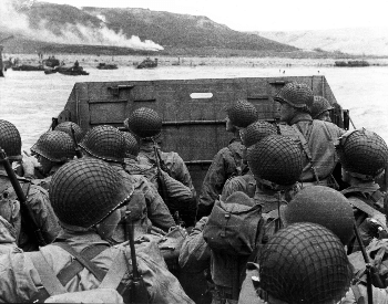 A picture of U.S. soliders on a landing craft on the coast of France