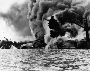 A picture of the USS Arizona (BB-39) sunk and burning after the attack
