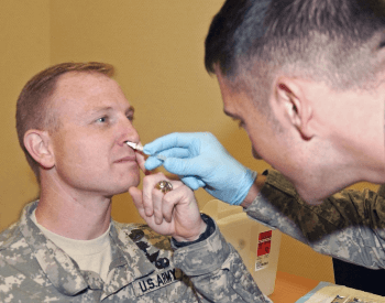 A vaccine being administered via nasal inhalation