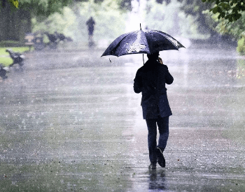 Walking in the rain with a umbrella