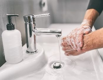 A picture of someone washing their hands with soap
