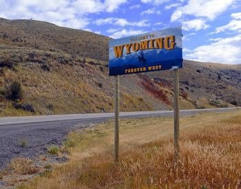 A picture of a sign that says welcome to Wyoming