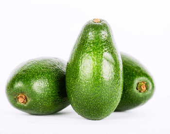 A picture of a few whole avocados
