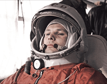 A photo of Yuri Gagarin on a bus in his cosmonaut space suit