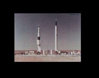 A picture of two Soviet Union rockets on the pad